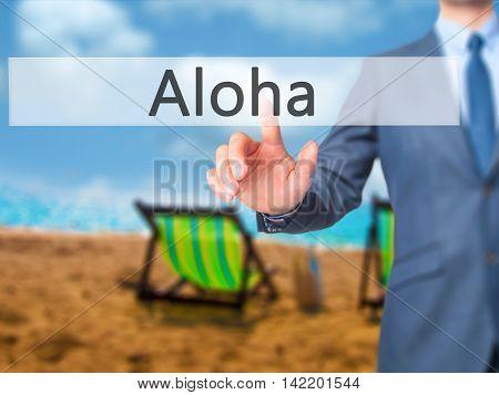 Aloha -  Businessman Press On Digital Screen.