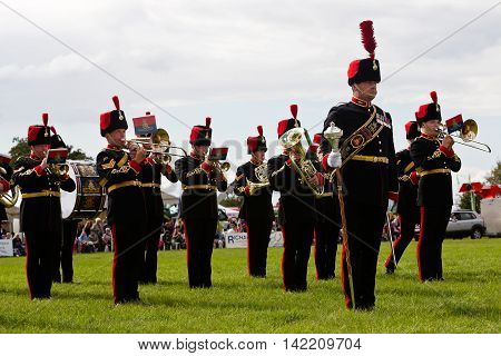 WEEDON, UK - AUGUST 27: Members of the band of the Royal Artillery give a marching display to the watching public in the main arena at the Bucks County show on August 27, 2015 in Weedon