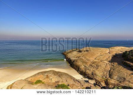 Stones and sea on Devil's beach in Ipanema Rio de Janeiro