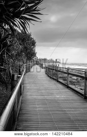 The boardwalk connects the beaches in Caloundra the beautiful beach town in Queensland Australia. There are similar boardwalks everywhere in the Sunshine coast.