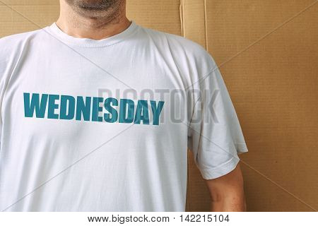 Days of the week - wednesday man wearing white t-shirt with name of the third weekday printed