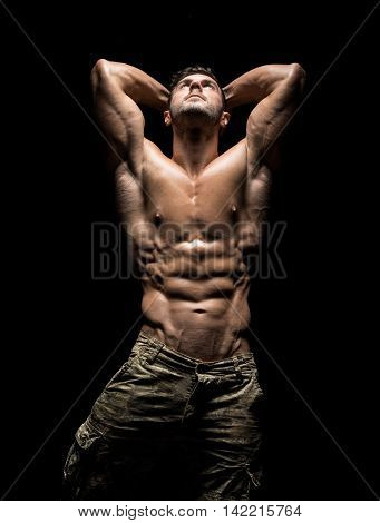 Muscular Athlete Bodybuilder Man On A Dark Background