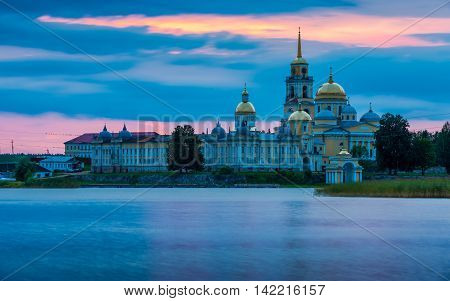 Nilov Monastery at sunset.Nilov Monastery is situated on Stolobny Island in Lake Seliger Tver region Russia.