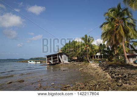Chea Village, Solomon Islands - May 31, 2015: Destroyed house along the coastline in a village on the Solomon Islands