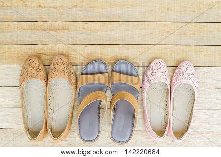 Female Shoes On Wood Background