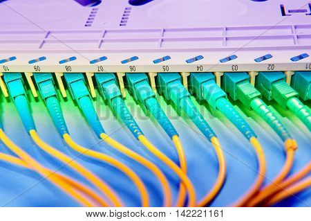 Fiber network switch with some yellow optical network cables