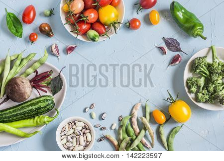 Food background. Assortment of fresh vegetables on a blue background. Top view free space for text