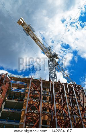 One of the buildings in Washington D.C. USA. The building is under the reconstruction works. The photo is taken from the bottom and the mechanical crane is in the background.