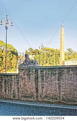 Roman Walls Of Piazza Del Popolo In Rome Of Italy