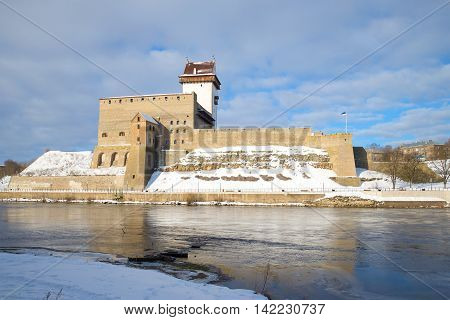 Herman's castle on the Narva river cloud March afternoon. Narva Estonia