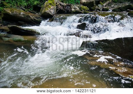 water  quickly hurries on stone in mountains