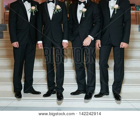Groom With Best Man And Groomsmen At Wedding.