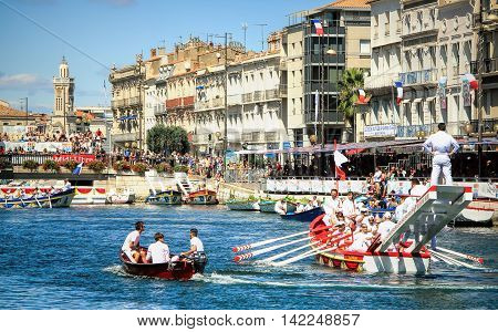 SETE FRANCE - August 23, 2014: Water Jousting performance during St.Louis festival at the streets of Sete South of France on August 23 2014.
