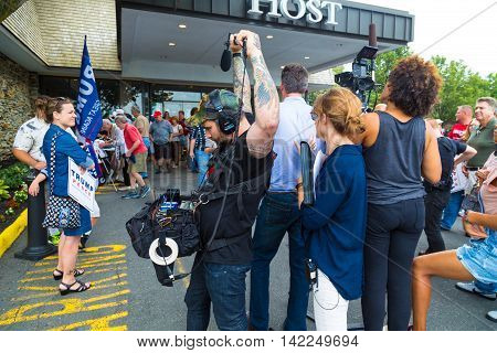 Lancaster PA - August 9 2016: Following the Governor Mike Pence political rally a woman speaks to the news media.