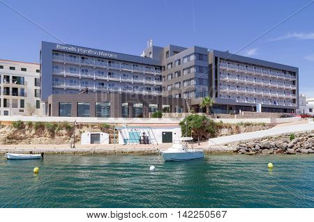 Mahon/Spain. 21st June 2012. The port of Mahon in Menorca on a warm summer's day. Port side luxury hotels enjoy prominent harbor views