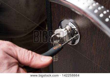 Lock Doors And Metal Screwdriver Close-up