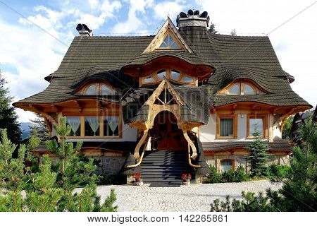 Zakopane, Poland, July 27, 2016: in Zakopane they created their own house style with steep roofs. The image shows a modern version of this house style.