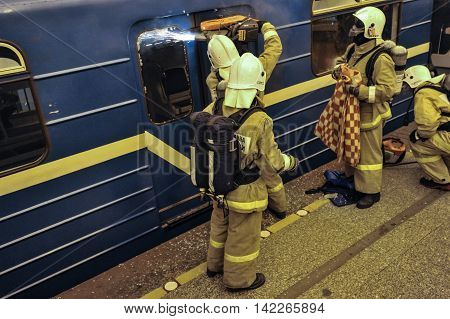Saint-Petersburg Russia - August 12 2016: Integrated special tactical exercises in the aftermath of the subway. Employees of Ministry of Emergency Situations rescue the victims of the incident.