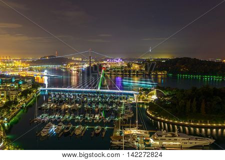 Night view of Keppel Bay marina, and Sentosa Island in Singapore