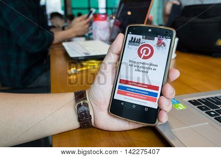 CHIANG MAITHAILAND - MAY 202016 : NEXUS with social Internet service Pinterest on the screen. Pinterest is an online pinboard that allows people to pin their interesting things.