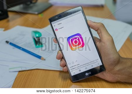 CHIANG MAI THAILAND - JULY 5 2016: A man holds LG G4 with new logo of Instagram application on the screen. Instagram is a photo-sharing app for smartphones.