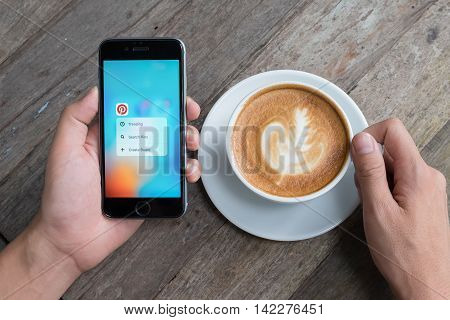 CHIANG MAI THAILAND - JULY 072016: A man holds Apple iPhone with Pinterest application 3D Touch on the screen. Pinterest is an online pinboard that allows people to pin their interesting things.