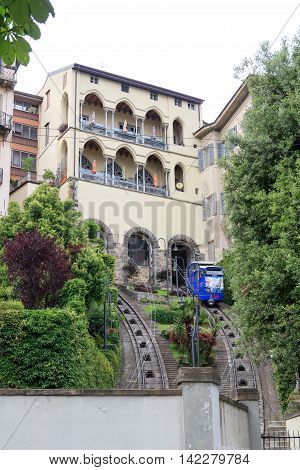 Bergamo, Italy - June 18, 2016: Funicular railway cable car to Citta Alta. Built in 1887 it connects the uppercity and downtown. The altitude difference is 85m.