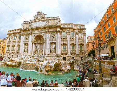 Rome Italy - May 02 2014: Tourists visiting the Trevi Fountain. Trevi Fountain is an iconic symbol of Imperial Rome. It is one of Rome's most popular tourist attractions.