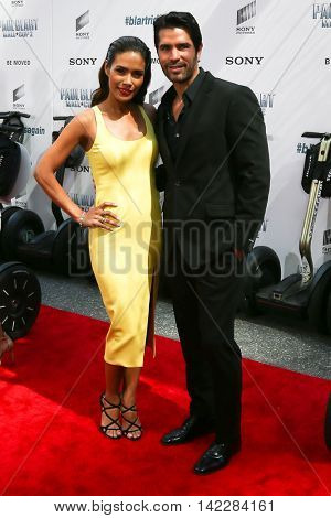 NEW YORK-APR 11: Actors Daniella Alonso (L) and Eduardo Verastegui attend the world premiere of