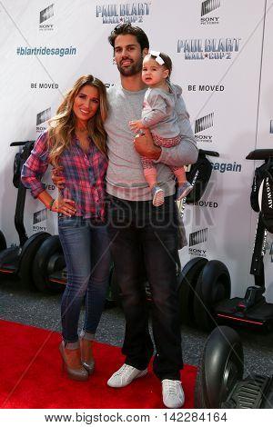 NEW YORK-APR 11: (L-R) Jessie James Decker, NFL player Eric Decker and daughter Vivianne attend the premiere of
