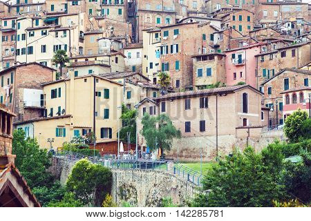 Old residential houses in medieval city of Siena Italy