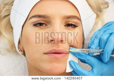 Young woman face injection hands with medical gloves beauty treatment