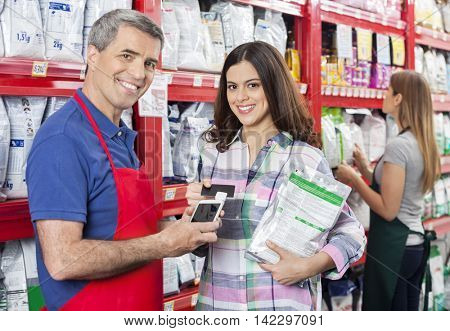 Customer Making Payment To Salesman In Pet Shop