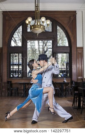Passionate Tango Dancers Performing In Restaurant