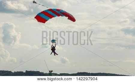Tandem skydiving on a large parachute. Preparing for landing.