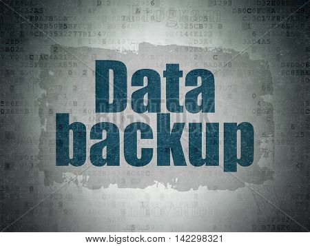 Information concept: Painted blue text Data Backup on Digital Data Paper background with   Tag Cloud