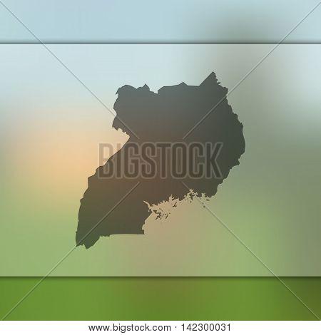 Uganda map on blurred background. Blurred background with silhouette of Uganda. Uganda. Blurred background. Uganda silhouette. Uganda vector map. Uganda flag.