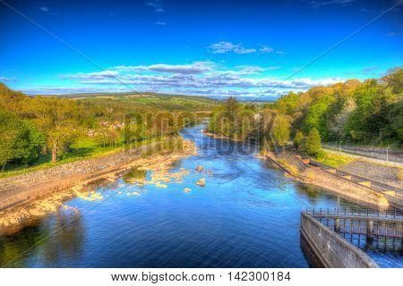 Pitlochry Scotland UK view of River Tummel in Perth and Kinross a popular tourist destination in summer in colourful hdr