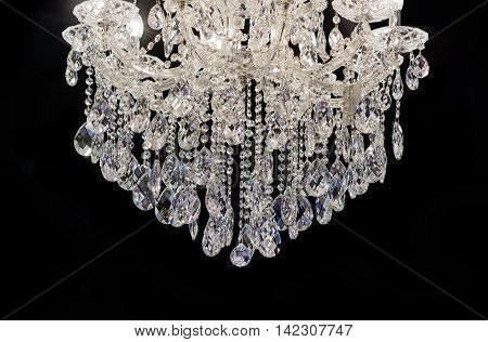 Chrystal chandelier close-up. black background with copy space
