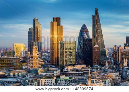 Skyscrapers of the world famous bank district of central London at sunset - England, UK