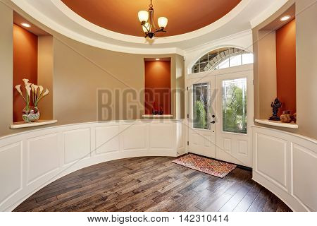 Gorgeous Entryway With Round Red Walls And Nice Decor