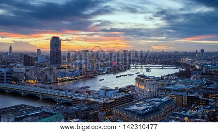 Skyline of central London with famous landmarks, River Thames, skyscrapers and Blackfriars Bridge at sunset - London, UK