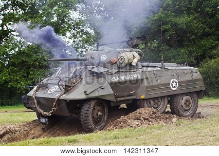 DENMEAD, UK - MAY 25: Reenactors play out a WW2 battle scenario between allied and axis forces at the Overlord military show on May 25, 2014 in Denmead