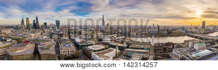 Panoramic skyline of east and south London at sunset. This wide view includes the famous financial Bank district, famous skyscrapers, Tate modern, River Thames and the Millennium Wheel - London, UK
