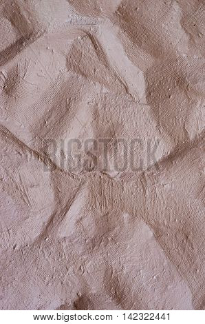 uneven surface of a clay brown wall