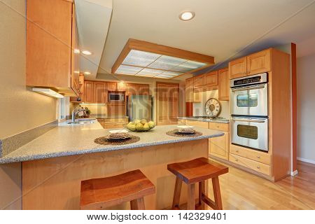 Bright Wooden Kitchen Interior With Steel Appliances.