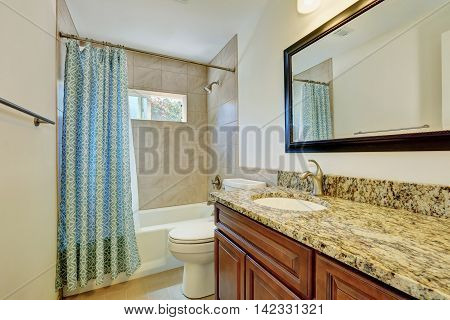 Nice Interior Of Bathroom With Vanity Cabinet And Marble Top