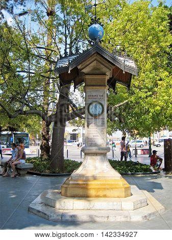 Palma de Majorca Spain - June 25 2008: Barometer monument in Palma de Majorca - resting people sitting around