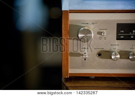 Vintage stereo receiver in wooden cabinet. Close up