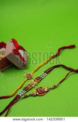 Indian festival: Raksha Bandhan background with Rakhi and Gift